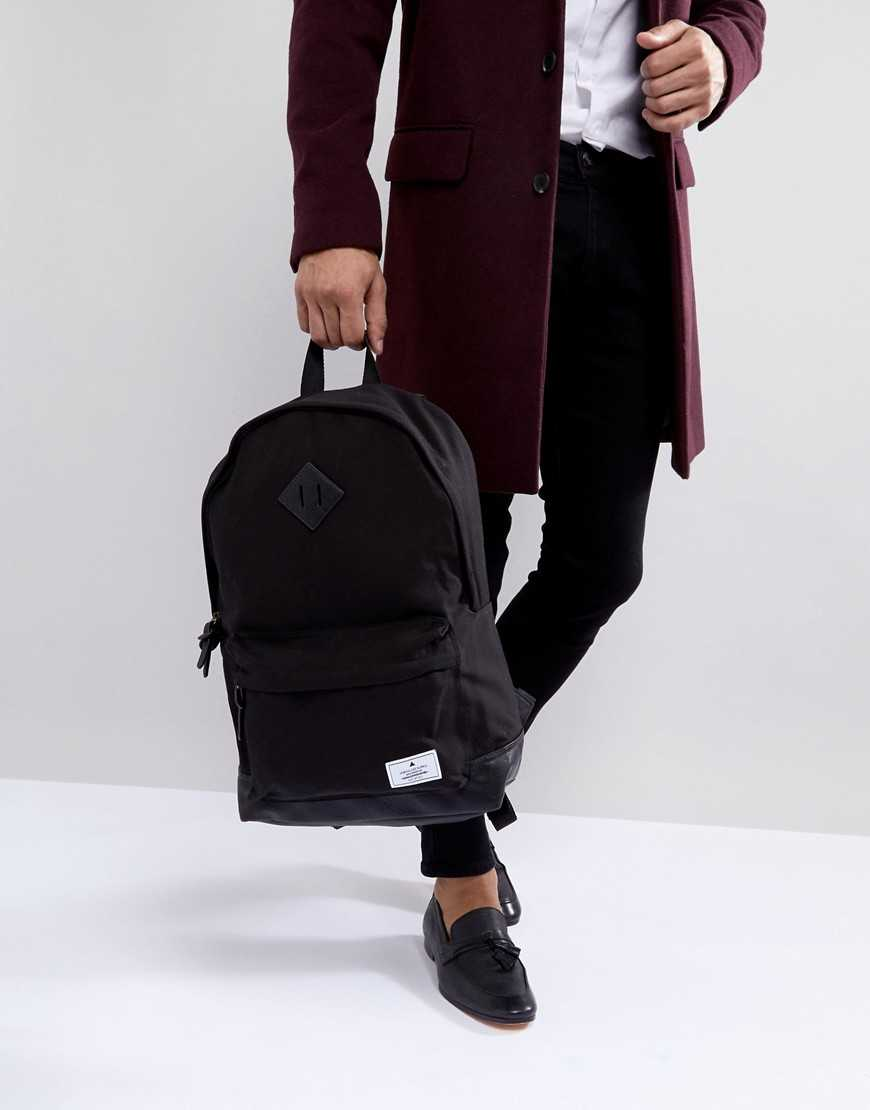 ASOS DESIGN backpack in black canvas with faux leather base - Black - Asos - GOOFASH