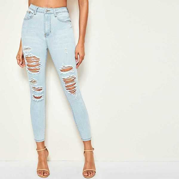 Light Wash Distressed Skinny Jeans in Blue by ROMWE on GOOFASH